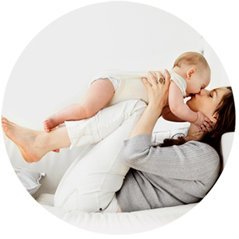 Hope's Relief Eczema Psoriasis Cream Mum lying on bed kissing baby