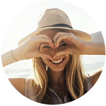 Hope's Relief Eczema Psoriasis Cream young woman wearing hat making heart symbol with hands
